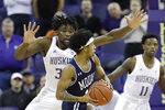 Washington's Isaiah Stewart, left, defends against Mount St. Mary's Damian Chong Qui during the first half of an NCAA college basketball game Tuesday, Nov. 12, 2019, in Seattle. (AP Photo/Elaine Thompson)