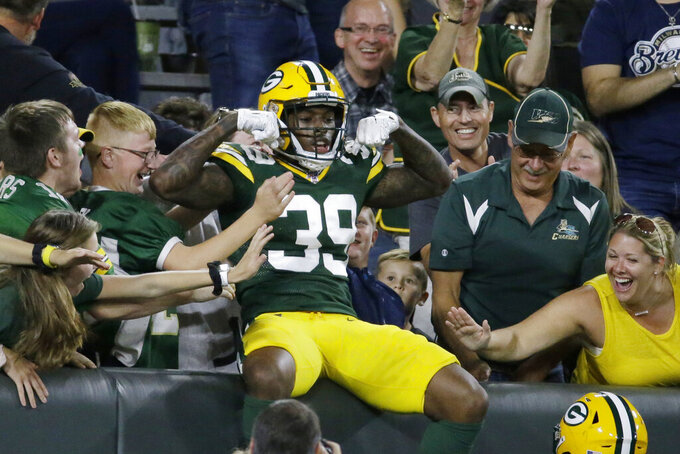 Green Bay Packers defensive back Chandon Sullivan celebrates a touchdown on an interception during the second half of the team's NFL preseason football game against the Houston Texans on Thursday, Aug. 8, 2019, in Green Bay, Wis. (AP Photo/Mike Roemer)