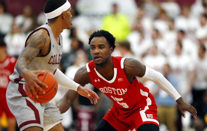 Boston University's  Jonas Harper (15) defends Colgate's Jordan Burns (1) during the first half of the NCAA Patriot League Conference college basketball championship at Cotterell Court, Wednesday, March 11, 2020, in Hamilton, N.Y. (AP Photo/John Munson)