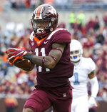 Virginia Tech's Tré Turner (11) scores on a 55-yard touchdown pass play ahead North Carolina Myles Dorn (1) during the first quarter of an NCAA college football game Saturday, Oct. 19 2019, in Blacksburg Va. (Matt Gentry/The Roanoke Times via AP)