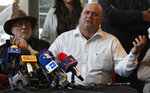 Julian LeBaron, who lost relatives and friends in a Nov. 4, 2019 ambush in northern Mexico, gives a press conference accompanied by Mexican writer and activist Javier Sicilia in Mexico City, Thursday, Jan. 9, 2020. Sicilia and other activists are calling to march against violence on Jan. 23, from Cuernavaca, Morelos state, to the National Palace in the Mexico's capital. (AP Photo/Marco Ugarte)