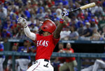 Texas Rangers' Delino DeShields follows through on a sacrifice fly to right on a pitch from Oakland Athletics' Chris Bassitt in the fifth inning of the second baseball game of a doubleheader in Arlington, Texas, Saturday, June 8, 2019.  Rangers' Ronald Guzman scored on the play. (AP Photo/Tony Gutierrez)