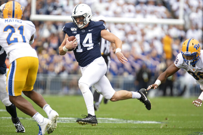 Penn State quarterback Sean Clifford (14) gains yardage on a run in the second quarter of an NCAA college football game in State College, Pa., on Saturday, Sept. 14, 2019. Penn State defeated Pittsburgh 17-10. (AP Photo/Barry Reeger)