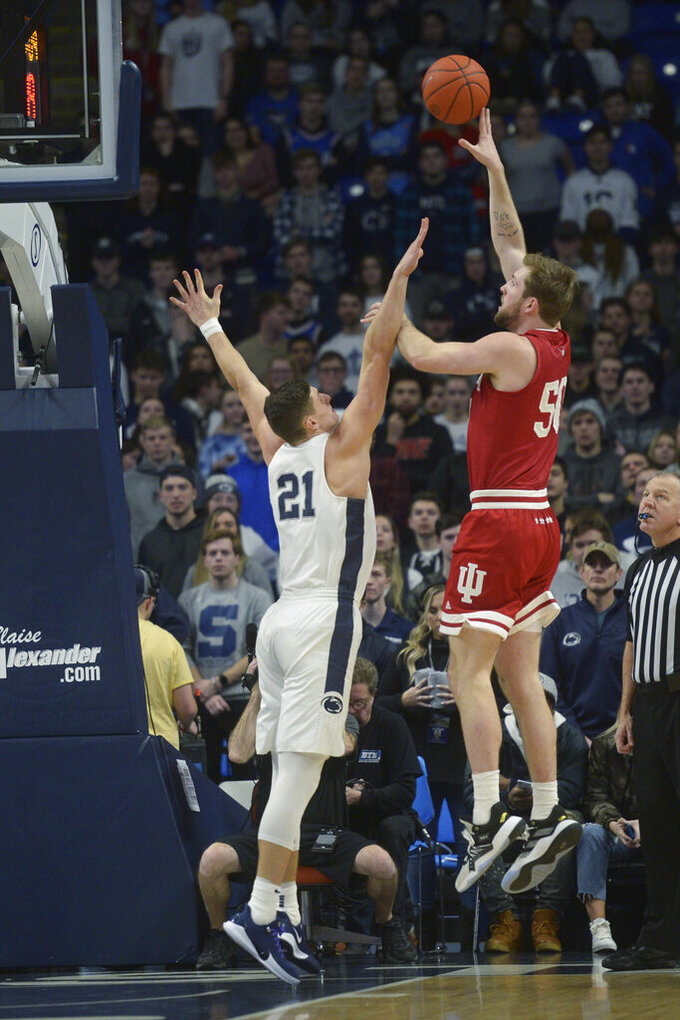 Indiana's Joey Brunk (50) puts up a one-handed shot over Penn State's John Harrar (21) during the first half of an NCAA college basketball game Wednesday, Jan. 29, 2020, in State College, Pa. (AP Photo/Gary M. Baranec)