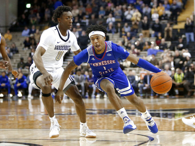 Tennessee State guard Michael Littlejohn (1) drives against Vanderbilt guard Saben Lee (0) in the first half of an NCAA college basketball game Saturday, Dec. 29, 2018, in Nashville, Tenn. (AP Photo/Mark Humphrey)