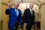 President Joe Biden joins Senate Majority Leader Chuck Schumer, D-N.Y., and fellow Democrats at the Capitol in Washington, Wednesday, July 14, 2021, to discuss the latest progress on his infrastructure agenda. (AP Photo/Andrew Harnik)