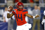 Arizona quarterback Khalil Tate looks to pass against Washington during the first half of an NCAA college football game Saturday, Oct. 12, 2019, in Tucson, Ariz. (AP Photo/Rick Scuteri)
