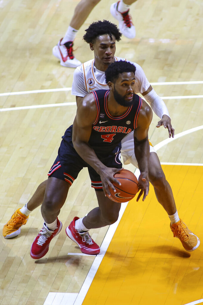 Georgia's Andrew Garcia (4) moves the ball against Tennessee during an NCAA college basketball game Wednesday, Feb. 10, 2021, in Knoxville, Tenn. (Randy Sartin/Pool Photo via AP)