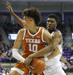 Texas forward Jaxson Hayes (10) tries to keep the ball from TCU center Kevin Samuel during the first half of an NCAA college basketball game in Fort Worth, Texas, Wednesday, Jan. 23, 2019. (AP Photo/LM Otero)