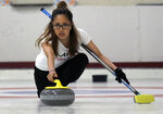 Kika Arias, of the Massachusetts Institute of Technology, delivers a rock during the college curling national championship, Friday, March 8, 2019, in Wayland, Mass. (AP Photo/Bill Sikes)