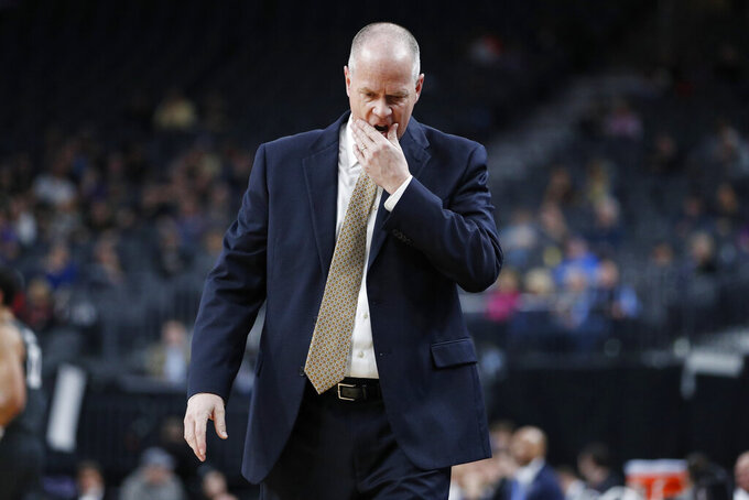 Colorado head coach Tad Boyle reacts after a play against Washington State during the first half of an NCAA college basketball game in the first round of the Pac-12 men's tournament Wednesday, March 11, 2020, in Las Vegas. (AP Photo/John Locher)