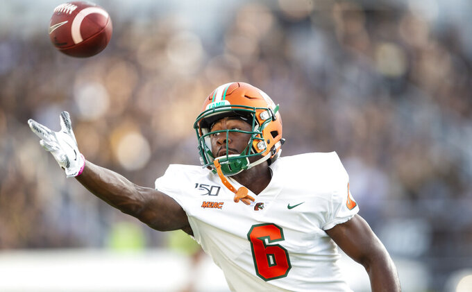 Florida A&M wide receiver Chris Sanders warms up before an NCAA college football game against Central Florida, Thursday, Aug. 29, 2019, in Orlando, Fla. (AP Photo/Willie J. Allen Jr.)