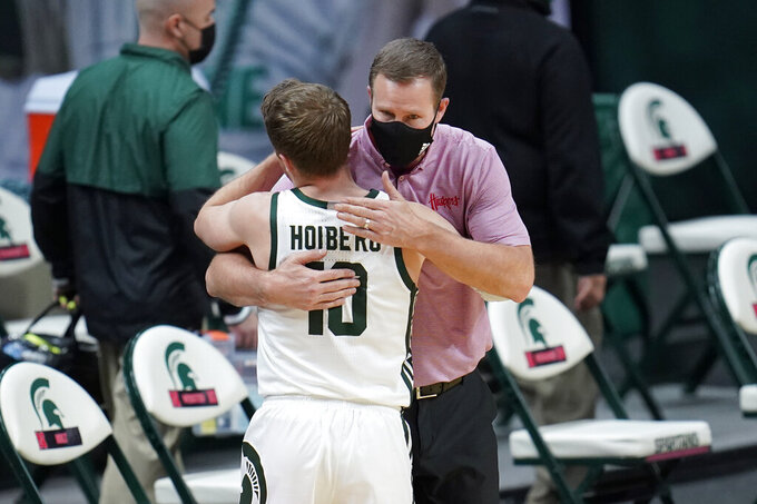 Michigan State guard Jack Hoiberg (10) hugs his father, Nebraska head coach Fred Hoiberg, after an NCAA college basketball game in East Lansing, Mich., Saturday, Feb. 6, 2021. Michigan State won 66-56. (AP Photo/Paul Sancya)
