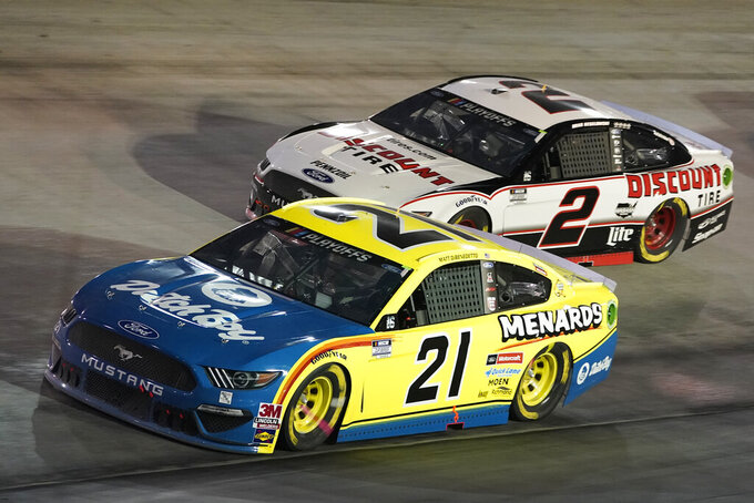 Matt DiBenedetto (21) and Brad Keselowski (2) drive into Turn 1 during the NASCAR Cup Series auto race Saturday, Sept. 19, 2020, in Bristol, Tenn. (AP Photo/Steve Helber)