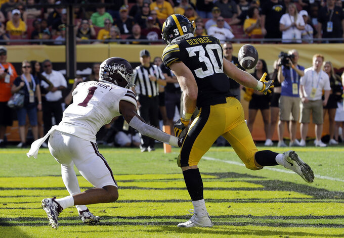Iowa defensive back Jake Gervase (30) reaches out to intercept a pass intended for Mississippi State wide receiver Stephen Guidry (1) during the second half of the Outback Bowl NCAA college football game Tuesday, Jan. 1, 2019, in Tampa, Fla. (AP Photo/Chris O'Meara)