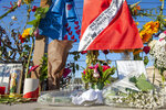 Items are placed at a memorial for the victims of Monday's dive boat fire at the Santa Barbara Harbor on Wednesday, Sept. 4, 2019, in Santa Barbara, Calif.  (AP Photo/Christian Monterrosa )
