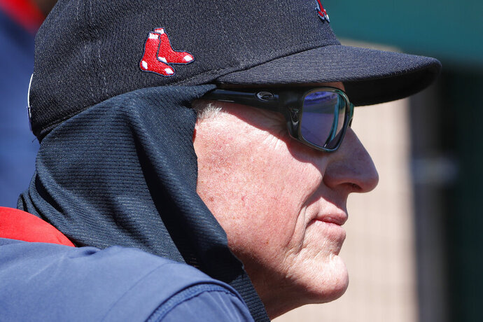 FILE - Boston Red Sox interim manager Ron Roenicke watches from the dugout during a spring training baseball game against the Houston Astros, Thursday, March 5, 2020, in Fort Myers, Fla. Roenicke was told Sunday, Sept. 27, 2020 he will not return as manager of the Red Sox, ending a one-year, shotgun stopgap on the final day of a pandemic-shortened season that resulted in a last-place finish in the AL East. (AP Photo/Elise Amendola, file)