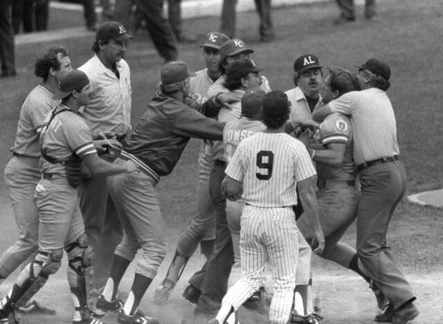FILE - In this July 24, 1983, file photo, Kansas City Royals' George Brett, second from right, is restrained by umpire Joe Brinkman after his bat was ruled illegal because of pine tar beyond the legal limit on the handle during a baseball game against the New York Yankees at Yankee Stadium in New York. Nearly three decades after it became known simply as