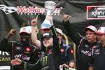 Ty Gibbs, center, celebrates with his pit crew after winning the NASCAR Xfinity Series auto race at Watkins Glen International in Watkins Glen, N.Y., Saturday, Aug. 7, 2021. (AP Photo/Joshua Bessex)