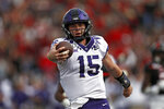 TCU's Max Duggan (15) scores a touchdown during the first half of an NCAA college football game against Texas Tech, Saturday, Nov. 16, 2019, in Lubbock, Texas. (Brad Tollefson/Lubbock Avalanche-Journal via AP)