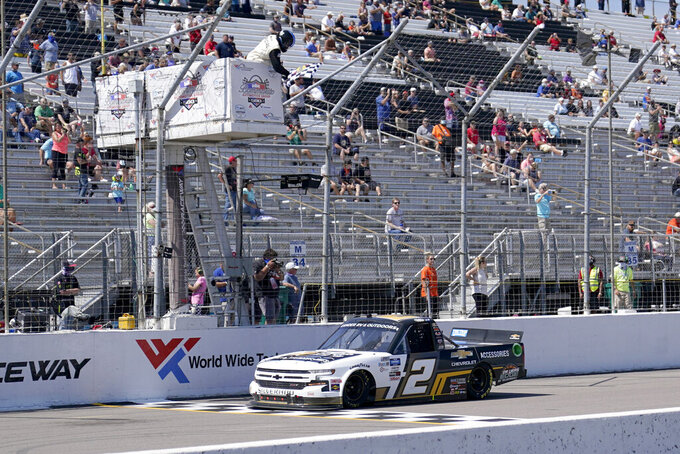 Sheldon Creed takes the checkered flag to win a NASCAR Truck Series race at World Wide Technology Raceway on Sunday, Aug. 30, 2020, in Madison, Ill. (AP Photo/Jeff Roberson)