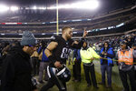 Philadelphia Eagles' Zach Ertz celebrates as he runs off the field after overtime of an NFL football game against the New York Giants, Monday, Dec. 9, 2019, in Philadelphia. (AP Photo/Matt Rourke)