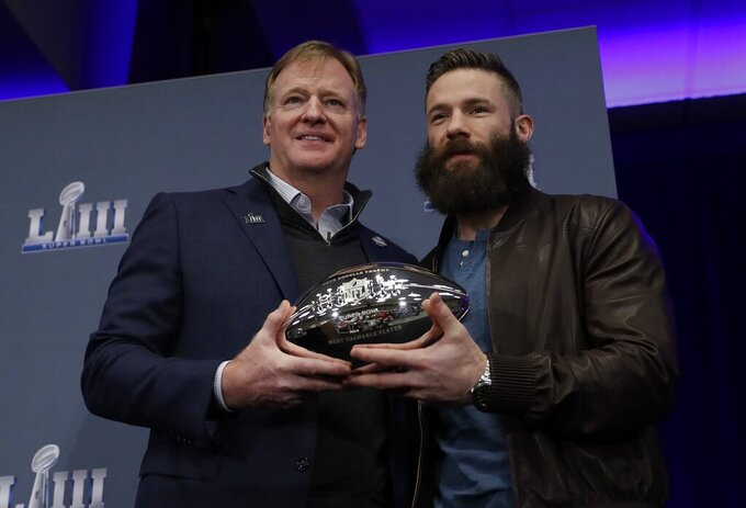 Super Bowl LIII MVP New England Patriots' Julian Edelman poses with NFL Commissioner Roger Goodell during a news conference for the NFL Super Bowl 53 football game Monday, Feb. 4, 2019, in Atlanta. The Patriots beat the Los Angeles Rams 13-3. (AP Photo/David J. Phillip)