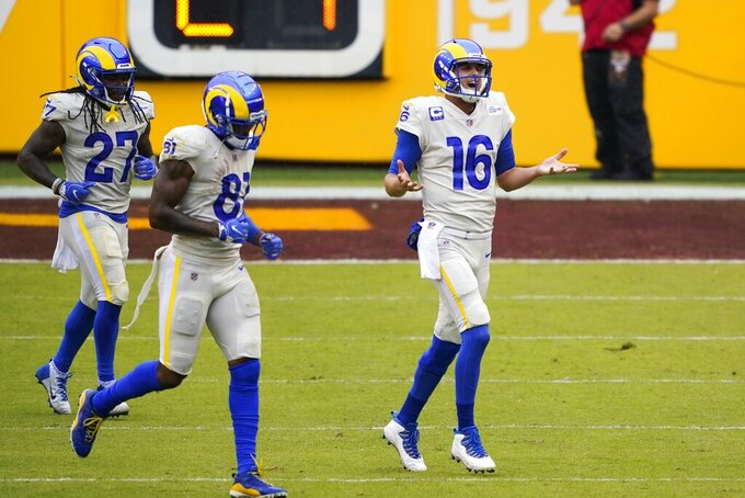 Los Angeles Rams' Jared Goff reacts after his touchdown run during the first half of an NFL football game against the Washington Football Team Sunday, Oct. 11, 2020, in Landover, Md. (AP Photo/Susan Walsh)