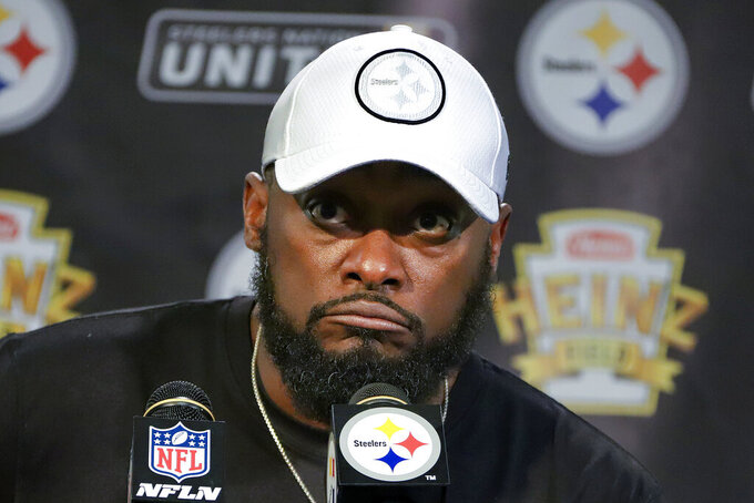 Pittsburgh Steelers head coach Mike Tomlin meets with reporters after an NFL football game against the Seattle Seahawks in Pittsburgh, Sunday, Sept. 15, 2019. (AP Photo/Gene J. Puskar)