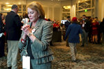 FILE - In this Nov. 3, 2020, file photo Cathy Harrison a supporter of Republican candidate Sen. Kelly Loeffler reacts at an election night watch party for Loeffler in Atlanta. (AP Photo/Tami Chappell, File)