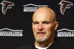FILE - In this Dec. 15, 2019, file photo, Atlanta Falcons head coach Dan Quinn speaks at a news conference after an NFL football game against the San Francisco 49ers in Santa Clara, Calif. The heat is on — and the games haven't even kicked off yet. That's life in the NFL for some coaches who enter the regular season knowing they need to guide their squads through what will be a most unusual regular season and at least keep them in playoff contention into December. (AP Photo/John Hefti, File)
