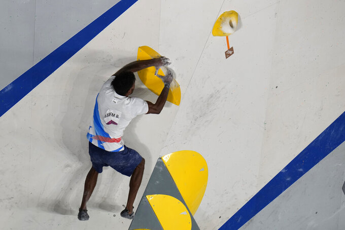 Bassa Mawem, of France, participates during the bouldering qualification portion of the men's sport climbing competition at the 2020 Summer Olympics, Tuesday, Aug. 3, 2021, in Tokyo, Japan. (AP Photo/Jeff Roberson)