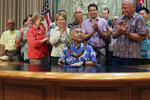 FILE - In this Wednesday, June 13, 2018, file photo, Hawaii lawmakers applaud in Honolulu after Hawaii Gov. David Ige signs legislation in banning a pesticide scientists have found could hinder the development of children's brains. Ige and state lawmakers say Hawaii is the first state to ban chlorpyrifos. The widely used agricultural pesticide chlorpyrifos that California environmental officials have said has been linked to brain damage in children will be banned after next year under an agreement reached with the manufacturer, state officials announced Wednesday, Oct. 9, 2019. (AP Photo/Audrey McAvoy, File)