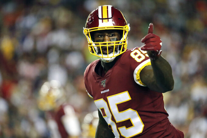 FILE - In this Monday, Sept. 23, 2019 file photo, Washington Redskins tight end Vernon Davis gestures toward a line judge during the first half of an NFL football game against the Chicago Bears in Landover, Md. Vernon Davis has decided to retire after 14 NFL seasons, Monday, Feb. 3, 2020. The 36-year-old says he wanted to walk away from football while his body was still healthy enough for him to pursue business and television opportunities. (AP Photo/Julio Cortez, File)