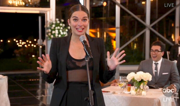 In this video grab captured on Sept. 20, 2020, courtesy of the Academy of Television Arts & Sciences and ABC Entertainment, Annie Murphy accepts the award for outstanding supporting actress in a comedy series for