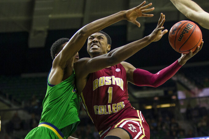 "FILE - In this Dec. 7, 2019, file photo, Boston College's Jairus Hamilton (1) drives against Notre Dame's Juwan Durham during an NCAA college basketball game in South Bend, Ind. Jairus Hamilton has committed to Maryland after playing basketball for two years for Boston College. Hamilton entered the transfer portal last week and announced his move to Maryland on Twitter on Wednesday, April 1, 2020, with the words, ""Beyond Blessed."" (Michael Caterina/South Bend Tribune via AP, File)"