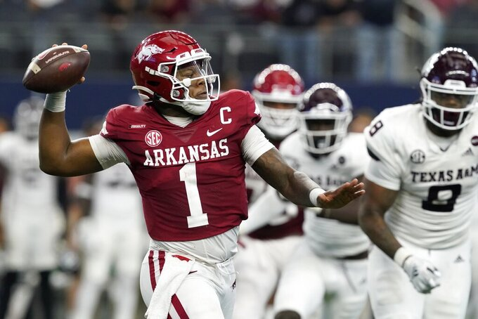 Arkansas quarterback KJ Jefferson (1) throws a pass under pressure from Texas A&M defensive lineman DeMarvin Leal (8) in the second half of an NCAA college football game in Arlington, Texas, Saturday, Sept. 25, 2021. (AP Photo/Tony Gutierrez)