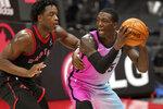 Miami Heat guard Kendrick Nunn (25) looks to pass around Toronto Raptors forward OG Anunoby (3) during the second half of an NBA basketball game Wednesday, Jan. 20, 2021, in Tampa, Fla. (AP Photo/Chris O'Meara)