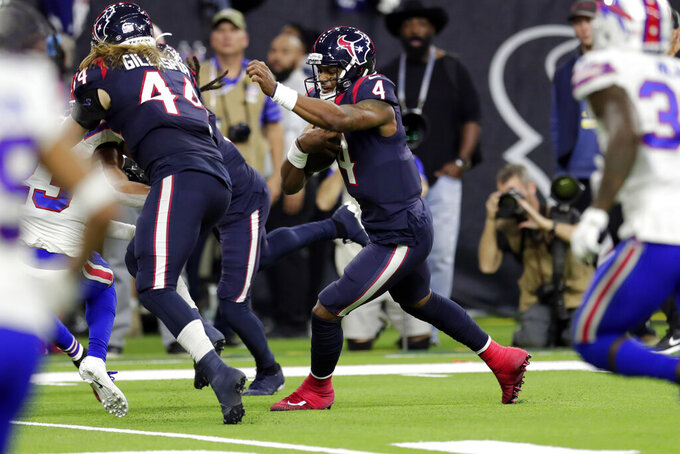 Houston Texans quarterback Deshaun Watson (4) runs for a touchdown against the Buffalo Bills during the second half of an NFL wild-card playoff football game Saturday, Jan. 4, 2020, in Houston. (AP Photo/Michael Wyke)