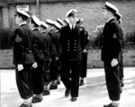 FILE - In this July 31, 1947 file photo, Lieut. Philip Mountbatten, center, inspects his men at the Petty Officers' Training Center at Corsham, England. Buckingham Palace officials say Prince Philip, the husband of Queen Elizabeth II, has died, it was announced on Friday, April 9, 2021. He was 99. Philip spent a month in hospital earlier this year before being released on March 16 to return to Windsor Castle. Philip, also known as the Duke of Edinburgh, married Elizabeth in 1947 and was the longest-serving consort in British history.  (AP Photo/File)