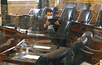 Del. David Reid, D-Loudoun, got to his desk to do some work early in the House Chamber inside the Virginia State Capitol in Richmond, Va., Tuesday, Aug. 3, 2021, on the second day of the General Assembly Special Session. (Bob Brown/Richmond Times-Dispatch via AP)