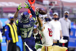 San Francisco 49ers tight end George Kittle (85) makes a catch as Seattle Seahawks free safety Quandre Diggs (37) defends during the second half of an NFL football game, Sunday, Jan. 3, 2021, in Glendale, Ariz. (AP Photo/Ross D. Franklin)