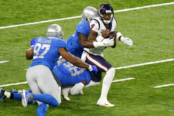 Houston Texans quarterback Deshaun Watson (4) is sacked during the first half of an NFL football game against the Detroit Lions, Thursday, Nov. 26, 2020, in Detroit. (AP Photo/Carlos Osorio)