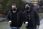 People wearing masks to help protect against the spread of coronavirus, walk, in Ankara, Turkey, Monday, Nov. 30, 2020.Turkey's President Recep Tayyip Erdogan has announced Monday the most widespread lockdown so far amid a surge in COVID-19 infections, extending curfews to weeknights and full lockdowns over weekends.(AP Photo/Burhan Ozbilici)
