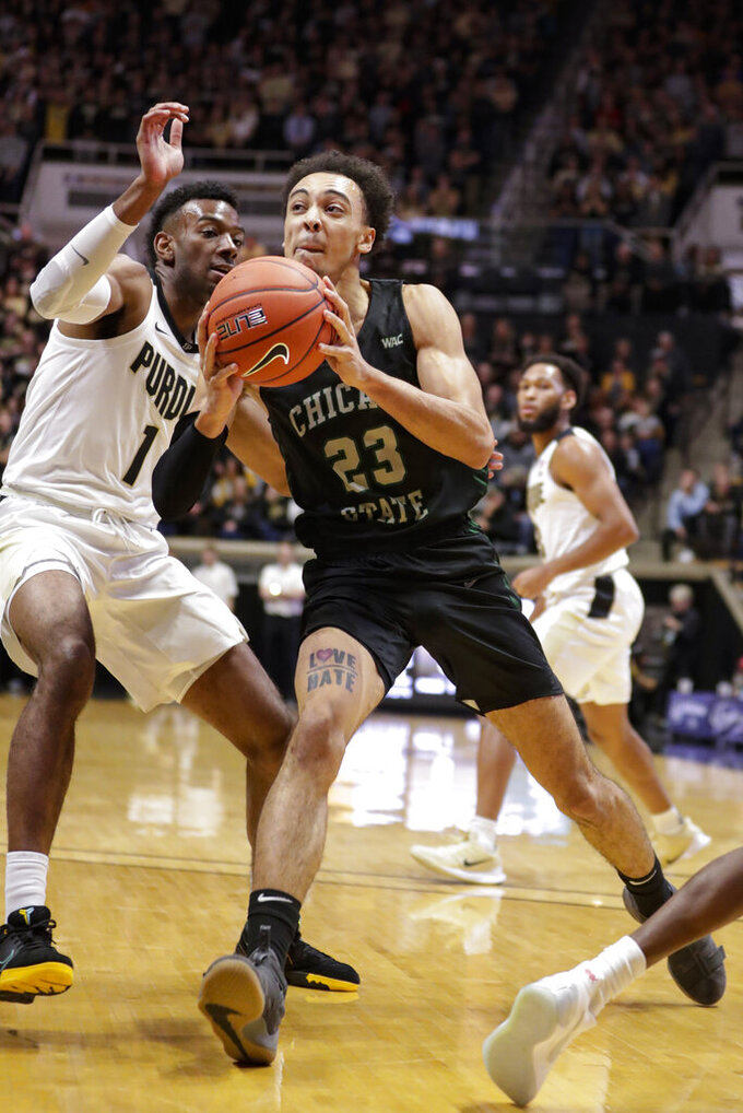 Chicago State forward Jace Colley (23) drives around Purdue forward Aaron Wheeler (1) during the first half of an NCAA college basketball game in West Lafayette, Ind., Saturday, Nov. 16, 2019. (AP Photo/Michael Conroy)