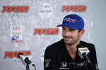 Alexander Rossi smiles during a news conference for Sunday's IndyCar Series auto race at Pocono Raceway, Saturday, Aug. 17, 2019, in Long Pond, Pa. (AP Photo/Matt Slocum)