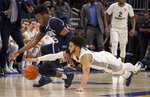 Marquette guard Markus Howard, right, dives for the ball against Villanova forward Saddiq Bey, left, during the second half of an NCAA college basketball game Saturday, Feb. 9, 2019, in Milwaukee. Marquette defeated Villanova 66-65. (AP Photo/Darren Hauck)