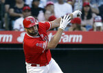 Los Angeles Angels' Albert Pujols drives in three runs with a double during the first inning of a baseball game against the Houston Astros on Tuesday, July 16, 2019, in Anaheim, Calif. (AP Photo/Marcio Jose Sanchez)