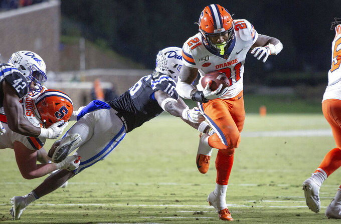 Syracuse's Moe Neal (21) carries the ball past Duke's Dylan Singleton (16) for a touchdown during the second half of an NCAA college football game in Durham, N.C., Saturday, Nov. 16, 2019. (AP Photo/Ben McKeown)