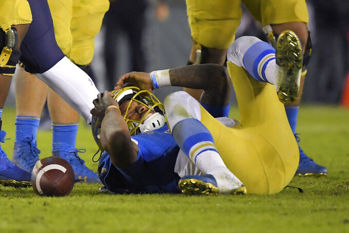UCLA quarterback Dorian Thompson-Robinson holds his head after being sacked during the second half of an NCAA college football game against California Saturday, Nov. 30, 2019, in Pasadena, Calif. California won 28-18. (AP Photo/Mark J. Terrill)